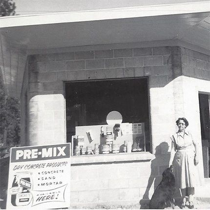 Ken's grandmother Marie in front of a new store, 1957